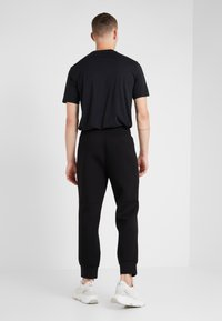Neil Barrett BLACKBARRETT - ELONGATED ZIP  - Pantalon de survêtement - black - 2