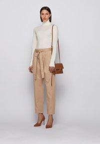 BOSS - TERMINE - Trousers - beige - 1