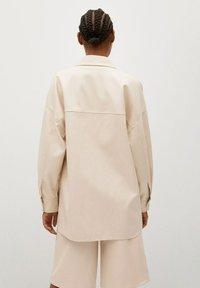 Mango - TRAVELER - Faux leather jacket - écru - 2