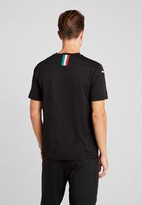 Puma - AC MAILAND 1899  - Club wear - black/tango red - 2