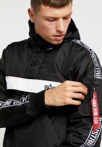 Alpha Industries - AL TAPE ANORAK - Light jacket - black - 4