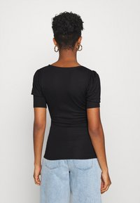 NA-KD - PUFF SLEEVE V DETAIL - Print T-shirt - black - 2