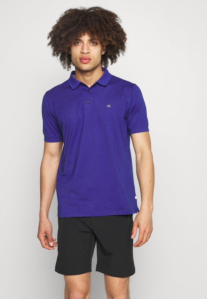 Calvin Klein Golf - PLANET - Polo shirt - indigo