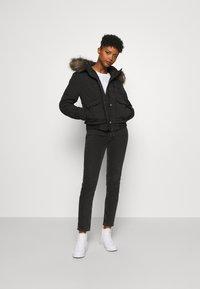 Superdry - EVEREST - Winter jacket - black - 1