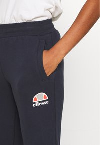 Ellesse - QUEENSTOWN - Tracksuit bottoms - dark blue