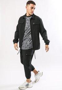 Ed Hardy - URBAN-TIGER NYLON POLY STRETCH SHACKET - Summer jacket - black - 1