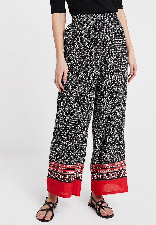 PERINUS TROUSERS - Trousers - chili