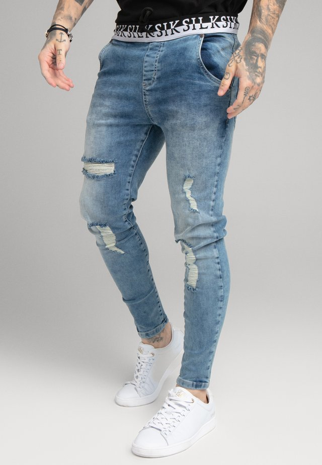 DISTRESSED ELASTICATED - Jeans Skinny Fit - washed raw blue