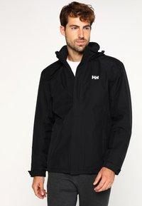 Helly Hansen - DUBLINER INSULATED JACKET - Waterproof jacket - black - 0