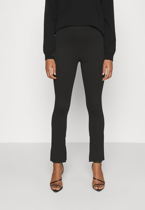 NA-KD X ZALANDO EXCLUSIVE  SIDE SLIT - Leggings - Trousers - black