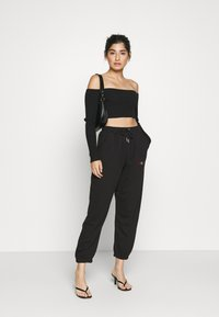 Missguided Petite - PRIDE JOGGERS - Tracksuit bottoms - black - 1