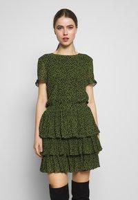 MICHAEL Michael Kors - MINI TIER DRESS - Day dress - black/evergreen - 0