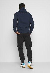 Tommy Jeans - LUV THE WORLD UNISEX - Pantalon de survêtement - black - 2