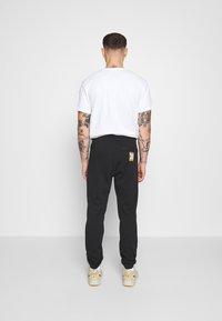 adidas Originals - LOGO - Pantaloni sportivi - black - 2