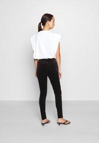 ONLY - ONLCATHY - Leggings - Trousers - black - 2