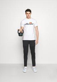 Ellesse - CELLA  - T-shirt z nadrukiem - white - 1