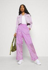 Nike Sportswear - STREET PANT - Pantalones - violet shock/white - 1