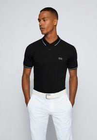 BOSS - PAULE - Polo shirt - black - 0