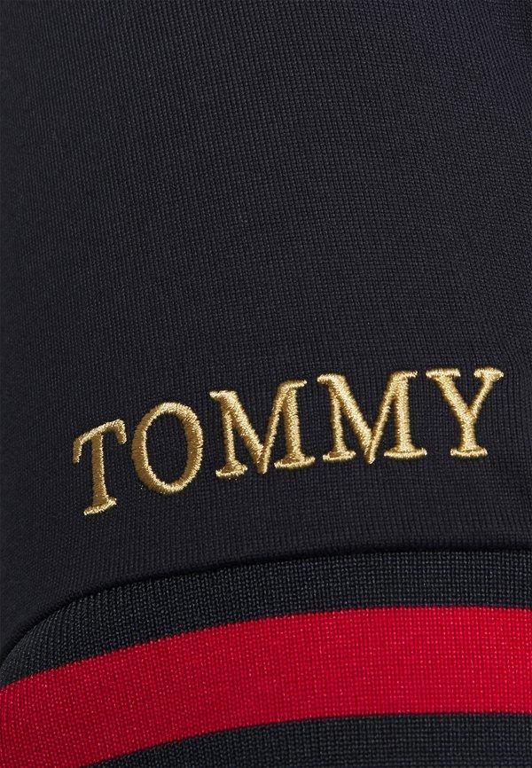 Tommy Hilfiger FLAG CUFF SLIM - Koszulka polo - desert sky/granatowy Odzież Męska RVKA