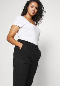 Vero Moda Curve - VMKAYA PANT - Trousers - black - 3