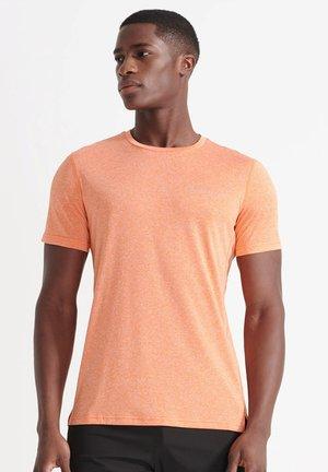 ACTIVE - Sports shirt - jaffa orange twist