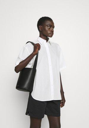 NET MINI BUCKET BAG - Handbag - nero