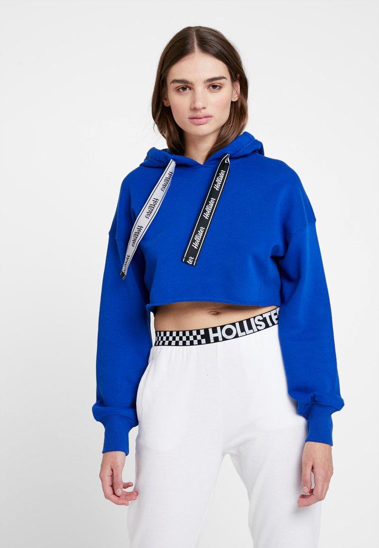 Hollister Co. - CROP BOYFRIEND POPOVER WITH LOGO TIES - Mikina skapucí - blue
