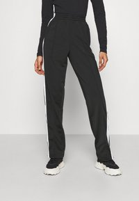 adidas Originals - ADIBREAK - Tracksuit bottoms - black - 0