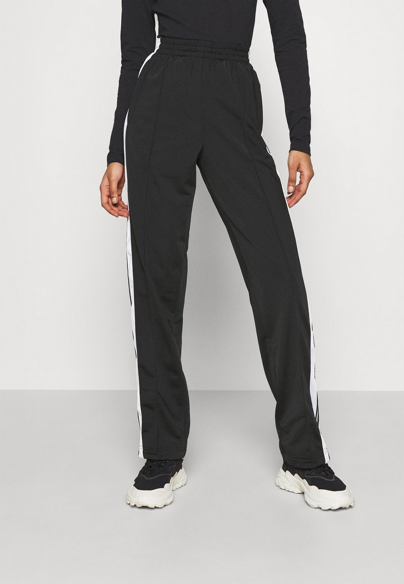 adidas Originals - ADIBREAK - Tracksuit bottoms - black