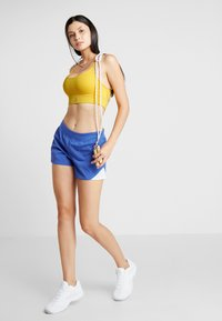 Reebok - NEW TRI BACK BRA PAD - Sports bra - toxic yellow - 1