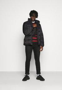 Redefined Rebel - PUFFER JACKET - Winter jacket - black solid - 1