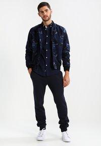 Pier One - Teplákové kalhoty - dark blue - 1