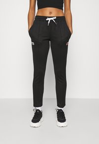 Ellesse - ADALINA - Tracksuit bottoms - black - 0