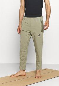adidas Performance - MENS YOGA PANT - Tracksuit bottoms - orbit green - 0