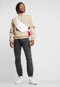 adidas Originals - MODULAR - Sweatshirt - hemp/white/power red - 1