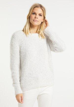 Stickad tröja - wollweiss