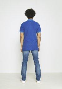 Tommy Jeans - GARMENT DYE - Polo shirt - blue - 2