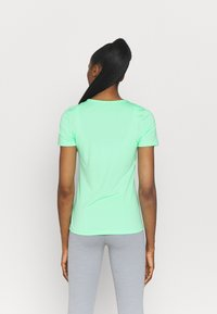 Nike Performance - ALL OVER - T-shirt - bas - green glow/white - 2
