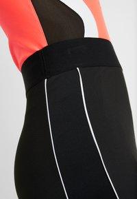 Puma - CLASSICS SKIRT - Pouzdrová sukně - black - 3