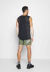adidas Performance - OWN THE RUN RESPONSE RUNNING  - Sports shorts - green - 2