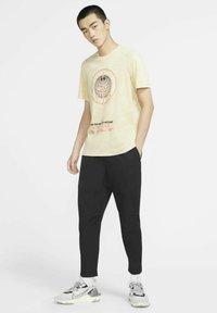 Nike Sportswear - Tracksuit bottoms - black/black - 1