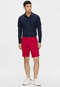 J.LINDEBERG - Sports shorts - red bell - 1