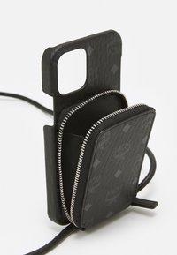MCM - IPHONE 12/12 PRO CASE WITH ZIP POCKET IN VISETOS ORIGINAL - Phone case - black - 2