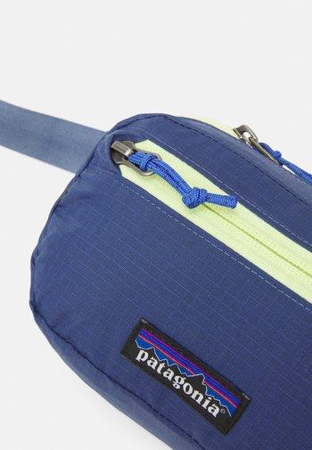 ULTRALIGHT BLACK HOLE MINI HIP PACK UNISEX - Bum bag - current blue
