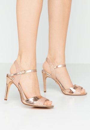 AIDA - Korolliset sandaalit - rosegold