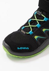 Lowa - MADDOX WARM GTX - Winter boots - black/lime - 2