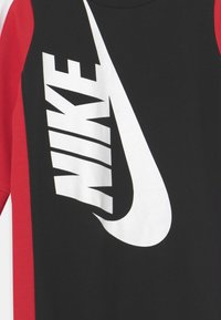Nike Sportswear - AMPLIFY COVERALL UNISEX - Jumpsuit - black - 2
