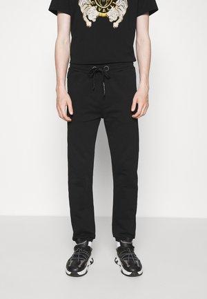 EXCLUSIVE - Teplákové kalhoty - black