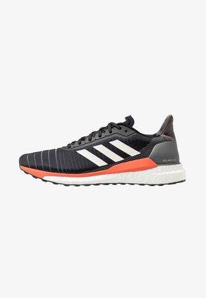 SOLAR GLIDE 19 - Neutral running shoes - core black/footwear white/solar orange