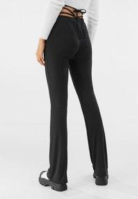 Bershka - Trousers - black - 2